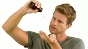 stock-footage-man-pouring-out-pills-on-white-background-in-slow-motion